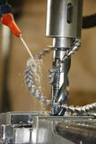 Metal drill press and shavings Stock Images