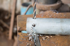 Metal drilling with a large drill Royalty Free Stock Photo