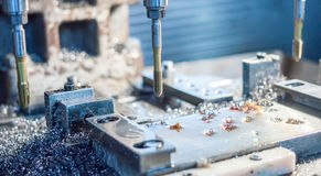 Metal drilling and tapping. Industrial metal drilling and tapping with many shavings Royalty Free Stock Image