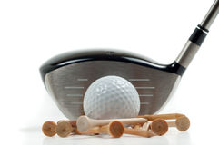 Metal driver with golf ball and tees Royalty Free Stock Image