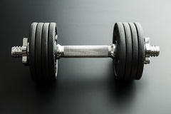 The metal dumbbell. Stock Photos