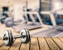 Metal dumbbell with gym background. 3d rendering metal dumbbell with gym background Royalty Free Stock Photo
