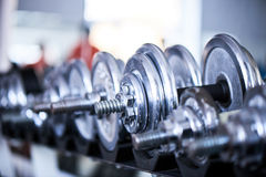 Metal dumbbells. With blurred background Stock Images