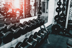 Metal dumbbells lying on gym fitness club Royalty Free Stock Photography