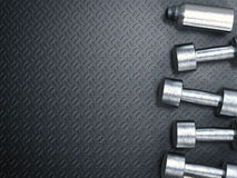 Metal dumbbells and metal bottle Royalty Free Stock Photography
