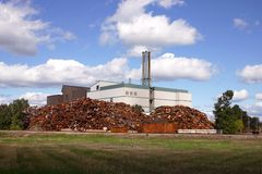 Metal dump factory. Metal dump  and incinerator in a blue sky Royalty Free Stock Image