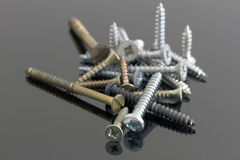 Metal e parafusos de bronze fotografia de stock royalty free