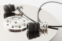Metal earphones on a disk Stock Photo