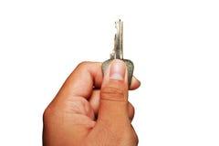 Metal el clave en la dirección ascendente en la mano aislada en pizca Imagen de archivo