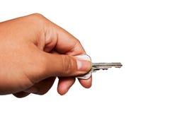 Metal el clave en la mano aislada en pizca Imagen de archivo libre de regalías