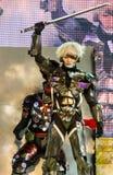 Metal el funcionamiento de levantamiento del engranaje en el mundo Cosplay 7 fantásticos de Oishi Foto de archivo