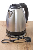 Metal electric kettle on the table stock photography