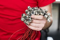 Metal electrical connectors with thread in the hand. Four pin contact group stock image