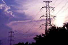 Metal electricity pylons. In sunset Stock Photos