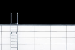 Metal emergency stairs on white wall Stock Image