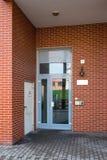 Metal entrance door in gray royalty free stock image