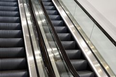 Metal Escalators with Nobody. Metal escalator staircases with nobody riding the steps Stock Photos