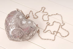 Metal evening handbag with chain, clutch has heart shape Stock Image