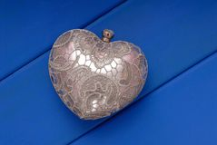 Metal evening handbag, clutch has heart shape,  symbol of Saint Royalty Free Stock Image