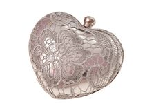 Metal evening handbag, clutch has heart shape, handbag is on whi Royalty Free Stock Images