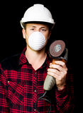 Metal fabrication workman with rotary disc sander Royalty Free Stock Images