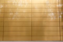 Metal facade cladding. Background. Golden color tiles Royalty Free Stock Images