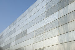 Metal facade. Facade of a modern building, covered with perforated sheets of stainless steel Stock Images