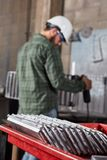Metal factory with metalworker. During metallurgy production Stock Photography