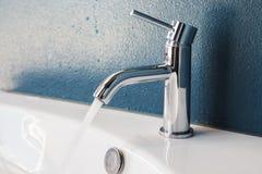 Metal faucet Stock Images