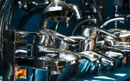 Metal faucets. For bathroom and kitchen royalty free stock images