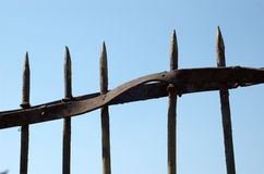 Metal fence. A twisted metal fence with spikes Royalty Free Stock Images