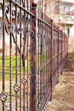 Metal fence around the house Royalty Free Stock Images
