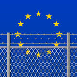 Metal fence with barbed wire on a European Union flag Separation concept Social issues on refugees or illegal immigrants Royalty Free Stock Photos