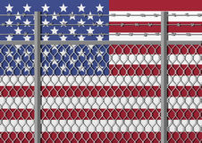 Metal fence with barbed wire on a USA flag. Separation concept, borders protection. Social issues on refugees Stock Photos