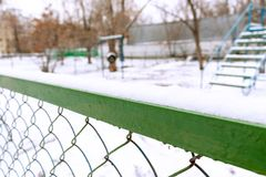 Metal fence and blurred empty dog area playground stock photo