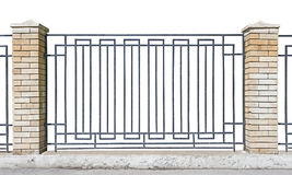 Metal fence with brick pillars Royalty Free Stock Images