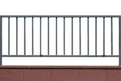 Metal fence and cement wall isolated Stock Photography