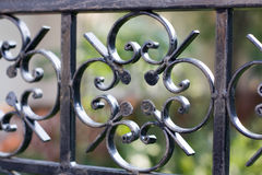 Metal fence. Close-up of a decorative iron fence Royalty Free Stock Photos