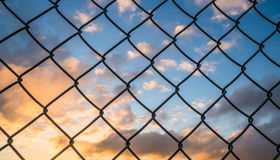 Metal fence with cloud and blue sky Royalty Free Stock Photo
