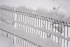 Metal fence covered with snow royalty free stock image