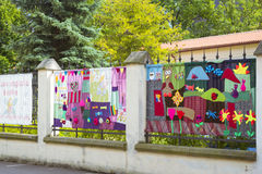 Metal fence decorated with knitted patterns with animals Stock Images