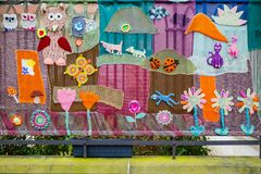 Metal fence decorated with pictures of animals and flowers from fabric. Prague, Czech Republic- March 28, 2018: Metal fence decorated with pictures of animals royalty free stock photos
