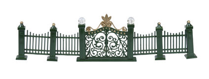 Metal Fence and Gate. Metal fence with scrollwork painted green with gate entrance - path included Stock Photos