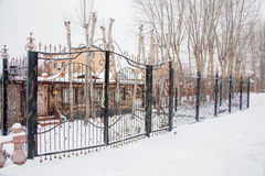 Metal fence with gates winter day Royalty Free Stock Images