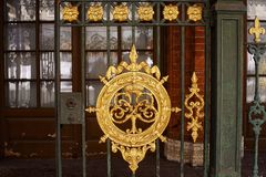 Metal fence gold blazon architecture detail outdoor. Gold blazon metal fence architecture detail outdoor sunlight Sankt-Petersburg Royalty Free Stock Images