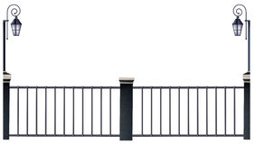 Metal fence and lampposts Stock Images