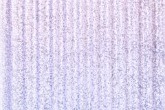 Metal fence in lilac color, with spots and grain. Texture of corrugated metal. Empty background stock illustration