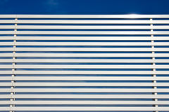 Metal fence lines and blue sky Stock Photography