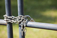 Metal fence with lock and chain Stock Photos