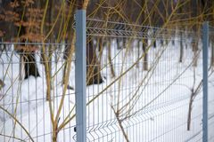 Metal fence mesh. New steel guardrail.  Royalty Free Stock Photography